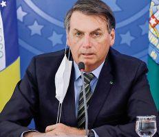 """"""" عودوا إلى العمل"""": الرئيس البرازيلي بولسونارو ينفي مخاطر فيروس كورونا"""