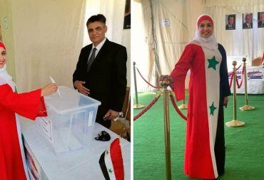 صورلسيدة ترتدي زي العلم السوري تنتخب في الأردن تشغل مواقع التواصل